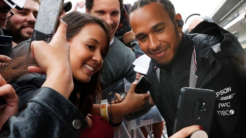 <p>               Mercedes driver Lewis Hamilton poses for photos with his fans during an autograph signing opportunity, ahead of the Formula One Grand Prix, in Mexico City, Thursday, Oct. 24, 2019. (AP Photo/Marco Ugarte)             </p>