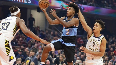 <p>               Cleveland Cavaliers' Collin Sexton (2) drives to the basket against Indiana Pacers' Malcolm Brogdon (7) and Myles Turner (33) in the first half of an NBA basketball game, Saturday, Oct. 26, 2019, in Cleveland. (AP Photo/Tony Dejak)             </p>