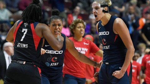 <p>               Washington Mystics' Elena Delle Donne, right, celebrates a play with Ariel Atkins, left, and Natasha Cloud, center, during the second half in Game 4 of basketball's WNBA Finals against the Connecticut Sun, Tuesday, Oct. 8, 2019, in Uncasville, Conn. (AP Photo/Jessica Hill)             </p>