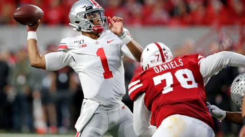<p>               Ohio State quarterback Justin Fields (1) throws a pass as Nebraska defensive lineman Darrion Daniels (79) defends during the first half of an NCAA college football game in Lincoln, Neb., Saturday, Sept. 28, 2019. (AP Photo/Nati Harnik)             </p>