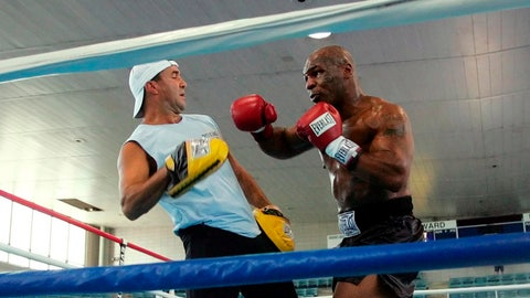 <p>               FILE - In this June 7, 2005, file photo, former Heavyweight Champion Mike Tyson, right, spars with his trainer Jeff Fenech in the ring at Burr Gymnasium in Washington. Fenech will undergo surgery in Bangkok to repair an infected heart valve. Australian boxer Jack Brubaker tells The Associated Press his mentor is hospitalized with a bad lung infection but remains conscious. (AP Photo/Pablo Martinez Monsivais, File)             </p>