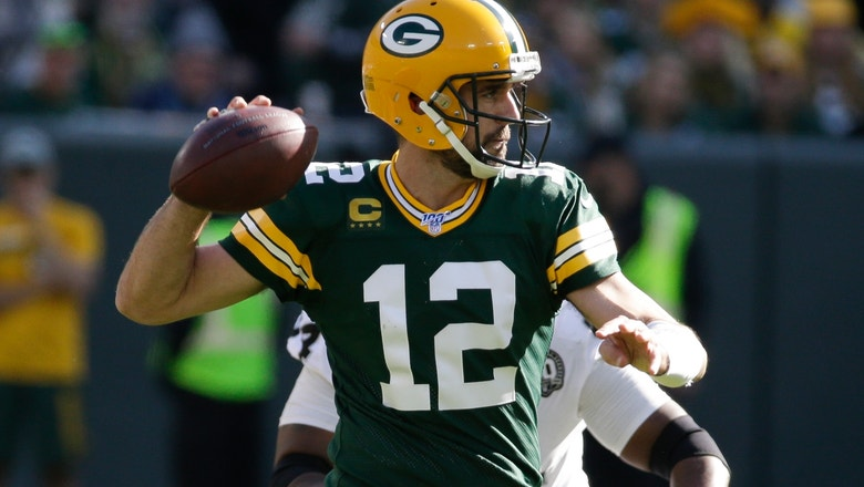 Rodgers has 5 TD passes, 1 rushing score as Packers roll