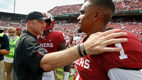 <p>               Texas Tech head coach Matt Wells, left, talks with Oklahoma quarterback Jalen Hurts (1) following their NCAA college football game in Norman, Okla., Saturday, Sept. 28, 2019. (AP Photo/Sue Ogrocki)             </p>