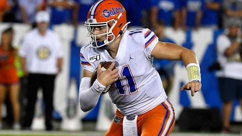 <p>               FILE - In this Sept. 14, 2019, file photo, Florida quarterback Kyle Trask (11) is shown running during the second half of an NCAA college football game in Lexington, Ky. With a collective seven career starts between them, No. 7 Auburn's quarterback Bo Nix and No. 10 Florida's Kyle Trask are set to face off in a Top 10 showdown. (AP Photo/Timothy D. Easley, File)             </p>
