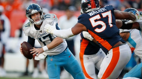 <p>               Tennessee Titans quarterback Ryan Tannehill looks to throw a pass under pressure from Denver Broncos defensive end DeMarcus Walker (57) during the second half of an NFL football game Sunday, Oct. 13, 2019, in Denver. (AP Photo/David Zalubowski)             </p>