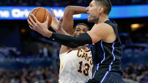 <p>               Orlando Magic's Nikola Vucevic, right, goes up for a shot past Cleveland Cavaliers' Tristan Thompson (13) during the first half of an NBA basketball game Wednesday, Oct. 23, 2019, in Orlando, Fla. (AP Photo/John Raoux)             </p>