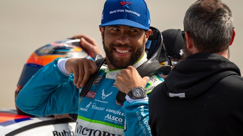 <p>               Driver Bubba Wallace gets ready to enter his car for qualifying rounds before the  NASCAR Xfinity Series auto race, Saturday, Oct. 5, 2019, in Dover, Del. (AP Photo/Brien Aho)             </p>