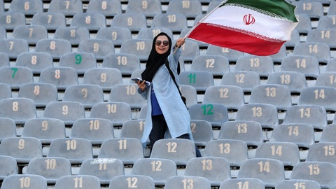 <p>               An Iranian woman waves her country's flag as she arrives at the Azadi Stadium to watch the 2022 World Cup qualifier soccer match between Iran and Cambodia, in Tehran, Iran, Thursday, Oct. 10, 2019. Iranian women are freely allowed into the stadium for the first time in decades. They had been banned since 1981. (AP Photo/Vahid Salemi)             </p>