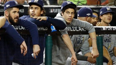 <p>               Milwaukee Brewers' Christian Yelich, third from left, sits in the dugout in the fifth inning of a National League wild card baseball game against the Washington Nationals, Tuesday, Oct. 1, 2019, in Washington. (AP Photo/Patrick Semansky)             </p>