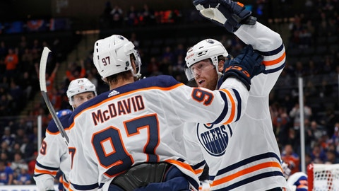 <p>               Edmonton Oilers left wing James Neal, right, celebrates with center Connor McDavid (97) after scoring a goal during the first period of the team's NHL hockey game against the New York Islanders, Tuesday, Oct. 8, 2019, in Uniondale, N.Y. Oilers center Leon Draisaitl is at back left. (AP Photo/Kathy Willens)             </p>