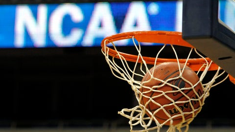 <p>               FILE - In this March 20, 2010, file photo, a ball flicks through the net in front of the NCAA logo on the marquis during an NCAA college basketball practice in Pittsburgh. Defying the NCAA, California's governor signed a first-in-the-nation law Monday, Sept. 30, that will let college athletes hire agents and make money from endorsements — a move that could upend amateur sports in the U.S. and trigger a legal challenge. (AP Photo/Keith Srakocic, File)             </p>