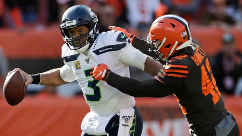 <p>               Seattle Seahawks quarterback Russell Wilson (3) avoids Cleveland Browns strong safety Morgan Burnett (42) during the second half of an NFL football game, Sunday, Oct. 13, 2019, in Cleveland. (AP Photo/Ron Schwane)             </p>