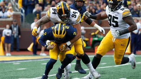 <p>               Iowa defensive end A.J. Epenesa (94) sacks Michigan quarterback Shea Patterson (2) during the first half of an NCAA college football game in Ann Arbor, Mich., Saturday, Oct. 5, 2019. (AP Photo/Paul Sancya)             </p>