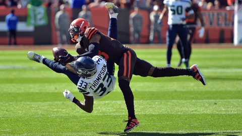 <p>               Cleveland Browns wide receiver Odell Beckham Jr. (13) catches a pass under pressure from Seattle Seahawks free safety Tedric Thompson (33) during the first half of an NFL football game, Sunday, Oct. 13, 2019, in Cleveland. (AP Photo/David Richard)             </p>