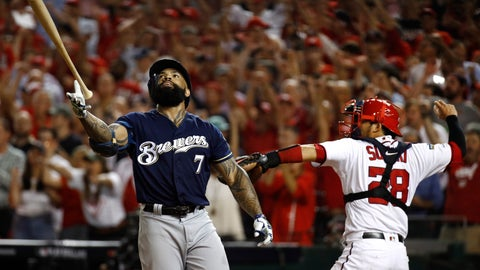 <p>               Milwaukee Brewers' Eric Thames, left, flips his bat after striking out in front of Washington Nationals catcher Kurt Suzuki in the ninth inning of a National League wild-card baseball game, Tuesday, Oct. 1, 2019, in Washington. Washington won 4-3. (AP Photo/Patrick Semansky)             </p>