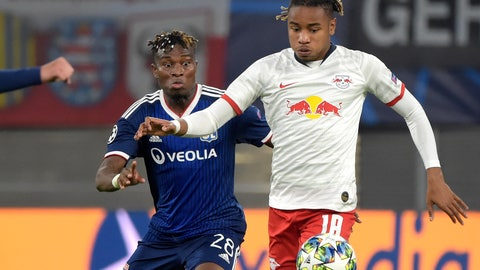 <p>               Lyon's Youssouf Kone, left, and Leipzig's Christopher Nkunku challenge for the ball during the Champions League group G first round soccer match between RB Leipzig and Olympique Lyon, in Leipzig, Germany, Wednesday, Oct. 2, 2019. (AP Photo/Jens Meyer)             </p>