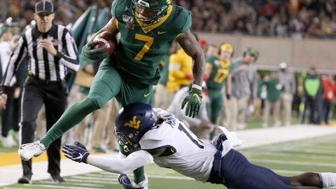 <p>               Baylor running back John Lovett (7) is tackled by West Virginia safety Kerry Martin Jr. (15) during the first half of an NCAA college football game in Waco, Texas, Thursday, Oct. 31, 2019. (AP Photo/Jerry Larson)             </p>