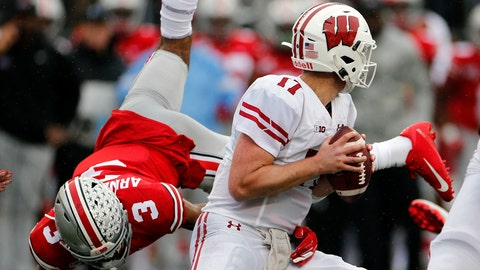 <p>               Wisconsin quarterback Jack Coan, right, escapes the grasp of Ohio State defensive back Damon Arnette during the first half of an NCAA college football game Saturday, Oct. 26, 2019, in Columbus, Ohio. (AP Photo/Jay LaPrete)             </p>