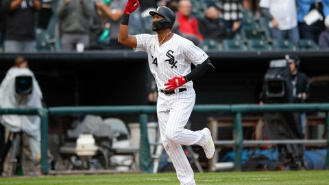 <p>               Chicago White Sox's Eloy Jimenez celebrates as he rounds the bases after hitting a solo home run off of Detroit Tigers' Edwin Jackson during the seventh inning of Game 1 of a baseball doubleheader, Saturday, Sept. 28, 2019, in Chicago. (AP Photo/Kamil Krzaczynski)             </p>