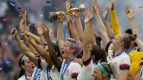 <p>               FILE - In this July 7, 2019, file photo, U.S. player Megan Rapinoe holds the trophy after winning the Women's World Cup final soccer match against The Netherlands at the Stade de Lyon in Decines, outside Lyon, France. Rapinoe is enjoying the whirlwind of a two-time World Cup winner. She picked up the FIFA Player of the Year award in Milan rocking a deeper shade of lavender hair, sent off retiring U.S. coach Jill Ellis with an undefeated victory tour and kept up the fight for pay equity against the U.S. Soccer Federation. (AP Photo/Claude Paris, File)             </p>