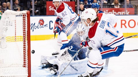 <p>               Montreal Canadiens centre Max Domi (13) scores on Toronto Maple Leafs goaltender Michael Hutchinson (30) during first period NHL action in Toronto, Saturday, Oct. 5, 2019. (Christopher Katsarov/The Canadian Press via AP)             </p>