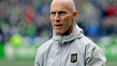 <p>               FILE - In this March 4, 2018, file photo Los Angeles head coach Bob Bradley walks across the pitch before an MLS soccer match against the Seattle Sounders in Seattle. Bradley was named MLS' Coach of the Year for the third time this week. (AP Photo/Ted S. Warren, File)             </p>