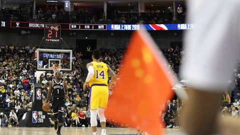 """<p>               In this Thursday, Oct. 10, 2019, photo, Brooklyn Nets' Theo Pinson, left, drives against Los Angeles Lakers' Danny Green, right, near a Chinese national flag during a preseason NBA game at the Mercedes Benz Arena in Shanghai, China. When Houston Rocket's general manager Daryl Morey tweeted last week in support of anti-government protests in Hong Kong, everything changed for NBA fans in China. A new chant flooded Chinese sports forums: """"I can live without basketball, but I can't live without my motherland."""" (AP Photo, File)             </p>"""