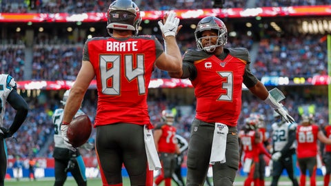 <p>               Tampa Bay Buccaneers tight end Cameron Brate (84) celebrates with quarterback Jameis Winston (3) after making a touchdown catch against the Carolina Panthers during the fourth quarter of an NFL football game, Sunday, Oct. 13, 2019, at Tottenham Hotspur Stadium in London. (AP Photo/Alastair Grant)             </p>