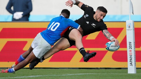 <p>               New Zealand's T J Perenara looks to score a try as he is tackled by Namibia's Helarius Kisting during the Rugby World Cup Pool B game at Tokyo Stadium between New Zealand and Namibia in Tokyo, Japan, Sunday, Oct. 6, 2019. The All Blacks defeated Namibia 71-9. (AP Photo/Christophe Ena)             </p>