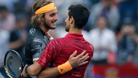 <p>               Stefanos Tsitsipas, left, of Greece is congratulated by Novak Djokovic of Serbia after winning in their men's singles quarterfinals match at the Shanghai Masters tennis tournament at Qizhong Forest Sports City Tennis Center in Shanghai, China, Friday, Oct. 11, 2019. (AP Photo/Andy Wong)             </p>