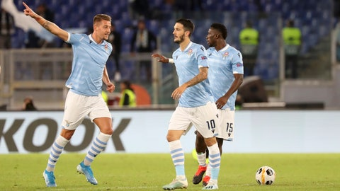 <p>               Lazio's Sergej Milinkovic-Savic, left, celebrates after scoring his side's first goal during the Europa League Group E soccer match between Lazio and Rennes, at Rome's Olympic Stadium, Thursday, Oct. 3, 2019. (AP Photo/Alessandra Tarantino)             </p>