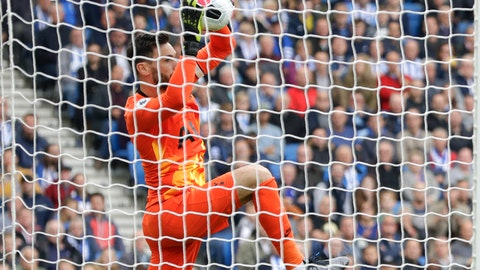 <p>               Tottenham's goalkeeper Hugo Lloris makes a save during the English Premier League soccer match between Brighton and Hove Albion and Tottenham Hotspur at Falmer stadium in Brighton, England Saturday, Oct. 5, 2019. (AP Photo/Kirsty Wigglesworth)             </p>