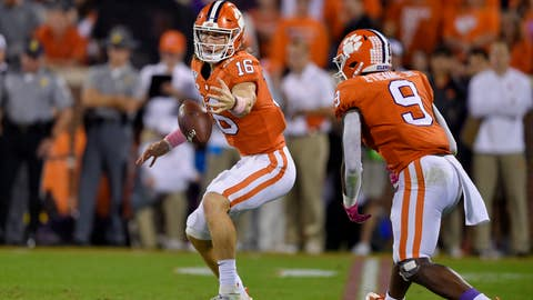 <p>               Clemson's Trevor Lawrence (16) grabs the ball in front of Travis Etienne after a bad snap during the first half of an NCAA college football game against Boston College, Saturday, Oct. 26, 2019, in Clemson, S.C. (AP Photo/Richard Shiro)             </p>