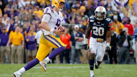 <p>               LSU quarterback Joe Burrow (9) carries for a touchdown in front of Auburn defensive back Jeremiah Dinson (20) in the second half of an NCAA college football game in Baton Rouge, La., Saturday, Oct. 26, 2019. (AP Photo/Gerald Herbert)             </p>