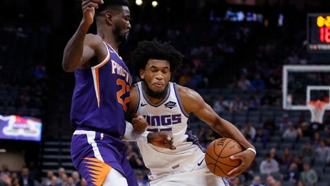 <p>               Phoenix Suns center Deandre Ayton, left, blocks he drive of Sacramento Kings forward Marvin Bagley III during the first quarter of an NBA preseason basketball game in Sacramento, Calif., Thursday, Oct. 10, 2019. (AP Photo/Rich Pedroncelli)             </p>