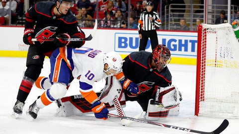 <p>               Carolina Hurricanes goaltender Petr Mrazek (34), of the Czech Republic, gloves the puck in front of a charging New York Islanders' Derick Brassard (10) with teammate Haydn Fleury (4) nearby during the first period of an NHL hockey game, in Raleigh, N.C., Friday, Oct. 11, 2019. (AP Photo/Karl B DeBlaker)             </p>