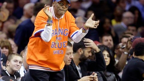 <p>               FILE - In this Oct. 30, 2014 file photo, filmmaker Spike Lee cheers during an NBA basketball game between the New York Knicks and Cleveland Cavaliers in Cleveland. Lee added to his New York Knicks collection by purchasing 13 items associated with his favorite team in a recent auction. The family of late Knicks coach Red Holzman sold off 35 items that netted $319,341, according to SCP Auctions, which handled last week's sale. (AP Photo/Tony Dejak, File)             </p>