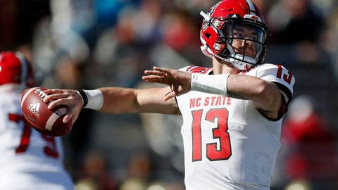 <p>               North Carolina State quarterback Devin Leary (13) passes against Boston College during the first half of an NCAA college football game in Boston, Saturday, Oct. 19, 2019. (AP Photo/Michael Dwyer)             </p>