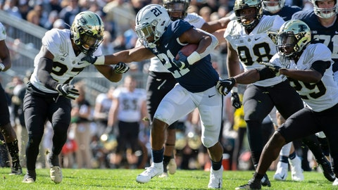 <p>               Penn State running back Noah Cain (21) stiff arms Purdue safety Navon Mosley (27) in the fourth quarter of an NCAA college football game in State College, Pa., on Saturday, Oct. 5, 2019. Penn State defeated Purdue 35-7. (AP Photo/Barry Reeger)             </p>