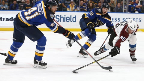 <p>               St. Louis Blues' Oskar Sundqvist (70), of Sweden, fends off Colorado Avalanche's Mikko Rantanen (96), of Finland, as teammate Robert Bortuzzo, left, clears the puck during the first period of an NHL hockey game Monday, Oct. 21, 2019, in St. Louis. (AP Photo/Scott Kane)             </p>