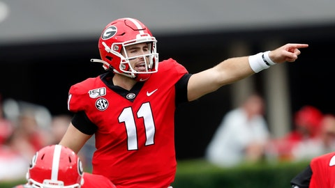 "<p>               FILE - In this Sept. 14, 2019, file photo, Georgia quarterback Jake Fromm (11) is shown In the first half of an NCAA college football game against Arkansas State, in Athens, Ga. Fromm says Jim Chaney, the Bulldogs' former offensive coordinator, ""really kind of introduced me to this pro-style offense."" Now Chaney is running Tennessee's offense, and Fromm wants to show he learned his lessons well when the No. 3 Bulldogs face the Vols on Saturday. (AP Photo/John Bazemore, File)             </p>"