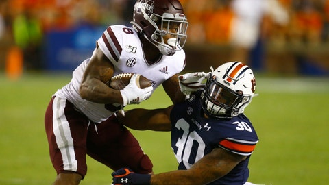 <p>               Mississippi State running back Kylin Hill (8) is tackled by Auburn linebacker Michael Harris (30) as he carries the ball during the second half of an NCAA college football game, Saturday, Sept. 28, 2019, in Auburn, Ala. (AP Photo/Butch Dill)             </p>