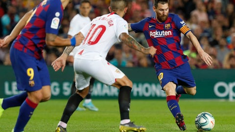 <p>               Barcelona's Lionel Messi, right, shoots the ball next to Sevilla's Ever Banega during Spanish La Liga soccer match between Barcelona and Sevilla at the Camp Nou stadium in Barcelona, Sunday, Oct. 6, 2019. Messi scored once in Barcelona's 4-0 victory. (AP Photo/Joan Monfort)             </p>