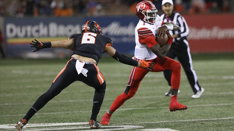 <p>               Utah quarterback Tyler Huntley (1) dodges Oregon State outside linebacker John McCartan (6) during the second half of an NCAA college football game in Corvallis, Ore., Saturday, Oct. 12, 2019. Utah won 52-7. (AP Photo/Amanda Loman)             </p>