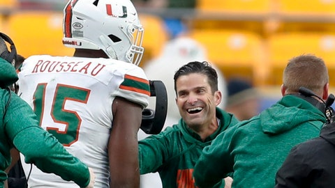 <p>               Miami defensive lineman Gregory Rousseau (15) celebrates with head coach Manny Diaz as their team leads with time running out against Pittsburgh in the second half of an NCAA college football game, Saturday, Oct. 26, 2019, in Pittsburgh. Miami won 16-12. (AP Photo/Keith Srakocic)             </p>
