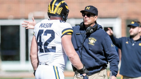 <p>               Michigan coach Jim Harbaugh talks with Ben Mason during the first half of an NCAA college football game against Illinois, Saturday, Oct. 12, 2019, in Champaign, Ill. (AP Photo/Holly Hart)             </p>