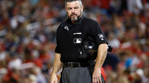 <p>               FILE - In this Sept. 13, 2019, file photo, umpire Rob Drake stands on the field during a baseball game between the Atlanta Braves and the Washington Nationals in Washington. Commissioner Rob Manfred says Major League Baseball will look into a politicized tweet by Drake that referenced a rifle and criticism of President Donald Trump. (AP Photo/Patrick Semansky, File)             </p>