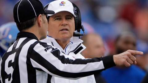 <p>               Kansas head coach Les Miles talks to an official during the first half of an NCAA college football game against Oklahoma, Saturday, Oct. 5, 2019, in Lawrence, Kan. (AP Photo/Charlie Riedel)             </p>
