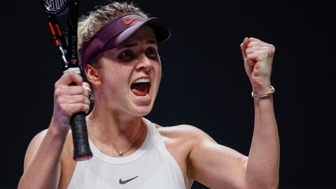 <p>               Elina Svitolina of Ukraine celebrates after defeating Simona Halep of Romania in their WTA Finals Tennis Tournament in Shenzhen, China's Guangdong province, Wednesday, Oct. 30, 2019. (AP Photo/Andy Wong)             </p>