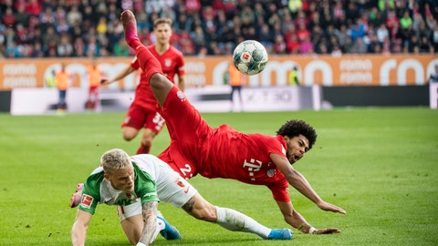 <p>               Augsburg's Philipp Max and Munich's Serge Gnabry challenge for the ball during a German Bundesliga soccer match between FC Augsburg and Bayern Munich in Augsburg, Germany, Saturday, Oct.19, 2019. (Matthias Balk/dpa via AP)             </p>